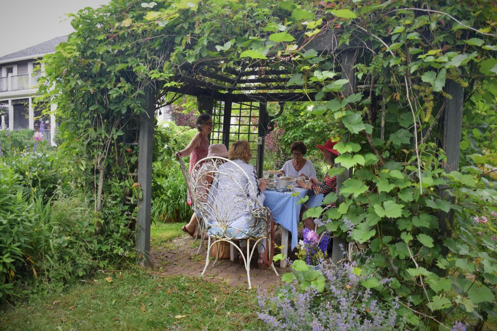 Victorian Garden Party A Success - drinking tea outside
