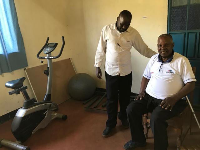 The Voice of the Disabled in Kenya doctor helping Kenyan
